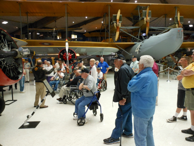 Welcome to the National Naval Aviation Museum and our tour guide Ron with the NC-4 in the background