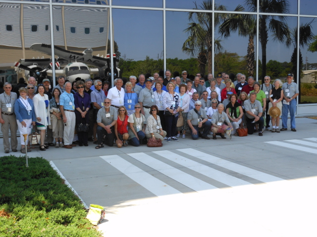 VS 31 Reunion attendees with the reflection of the S2 and the National Flight Academy